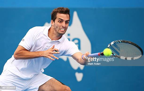 Albert Ramos of Spain plays a forehand in his match against Radek Steponek of the Czech Republic during day four of the 2014 Sydney International at...