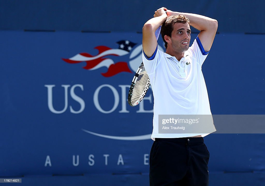 <a gi-track='captionPersonalityLinkClicked' href=/galleries/search?phrase=Albert+Ramos&family=editorial&specificpeople=6878507 ng-click='$event.stopPropagation()'>Albert Ramos</a> of Spain reacts next to his partner Fabio Fognini of Italy during their men's doubles first round match against John-Patrick Smith of Australia and Paul Hanley of Australia on Day Two of the 2013 US Open at USTA Billie Jean King National Tennis Center on August 27, 2013 in the Flushing neighborhood of the Queens borough of New York City.