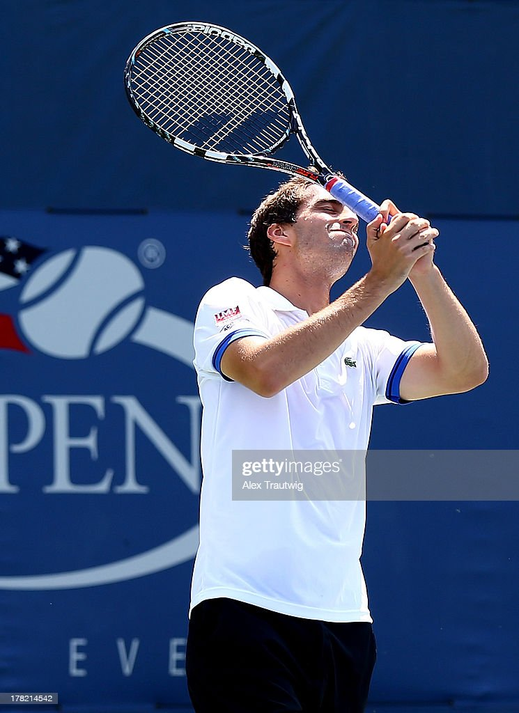 Albert Ramos of Spain reacts next to his partner Fabio Fognini of Italy during their men's doubles first round match against John-Patrick Smith of Australia and Paul Hanley of Australia on Day Two of the 2013 US Open at USTA Billie Jean King National Tennis Center on August 27, 2013 in the Flushing neighborhood of the Queens borough of New York City.