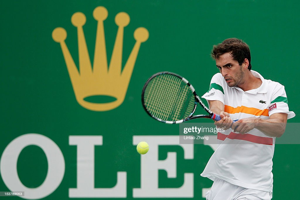 <a gi-track='captionPersonalityLinkClicked' href=/galleries/search?phrase=Albert+Ramos&family=editorial&specificpeople=6878507 ng-click='$event.stopPropagation()'>Albert Ramos</a> of Spain returns a shot to Stanislas Wawrinka of Switzerland during the day three of Shanghai Rolex Masters at the Qi Zhong Tennis Center on October 9, 2012 in Shanghai, China.