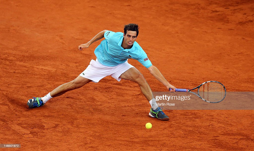 <a gi-track='captionPersonalityLinkClicked' href=/galleries/search?phrase=Albert+Ramos&family=editorial&specificpeople=6878507 ng-click='$event.stopPropagation()'>Albert Ramos</a> of Spain returns to Lukas Rosol of Czech Republic during the bet-at-home German Open Tennis Championships 2012 at Rothenbaumon July 18, 2012 in Hamburg, Germany.