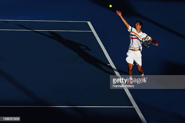 Albert Ramos of Spain serves during his first round match against Olivier Rochus of Belgium during day one of the Heineken Open at ASB Tennis Centre...