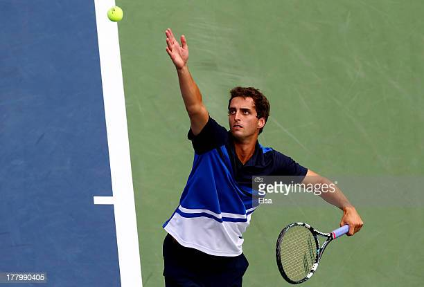 Albert Ramos of Spain serves to Bernard Tomic of Australia during their first round men's singles match on Day One of the 2013 US Open at USTA Billie...