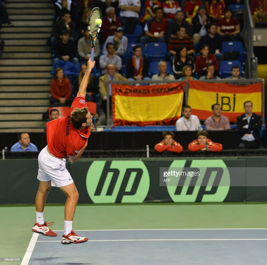 Albert Ramos of Spain serves to Milos Raonic of Canada, during a Davis Cup World Group first round tie at the Doug Mitchell Thunderbird Sports Centre in Vancouver on February 1, 2013. AFP PHOTO/Don MacKinnon