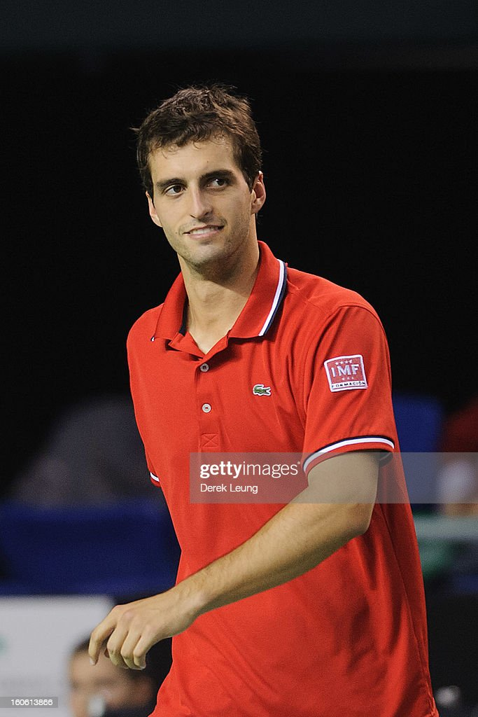<a gi-track='captionPersonalityLinkClicked' href=/galleries/search?phrase=Albert+Ramos&family=editorial&specificpeople=6878507 ng-click='$event.stopPropagation()'>Albert Ramos</a> of Spain smiles during his singles match against Frank Dancevic of Canada on day three of the 2013 Davis Cup on February 3, 2013 at UBC Thunderbird Arena in Vancouver, British Columbia, Canada. Albert defeated Frank.