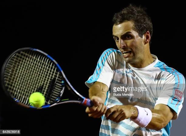 Albert Ramos Vinolas of Spain returns a shot to Fabio Fognini of Italy during the ATP Rio Open 2017 at Jockey Club Brasileiro on February 22 2017 in...