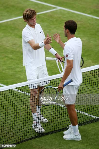 Albert RamosVinolas of Spain and Andrey Rublev of Russia shake hands after the Gentlemen's Singles second round match on day four of the Wimbledon...