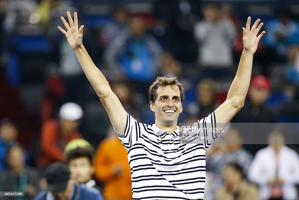 Albert Ramos-Vinolas of Spain celebrates after winning his match against Roger Federer of Switzerland during their men's singles second round match on day 3 of Shanghai Rolex Masters at Qi Zhong Tennis Centre on October 13, 2015 in Shanghai, China.