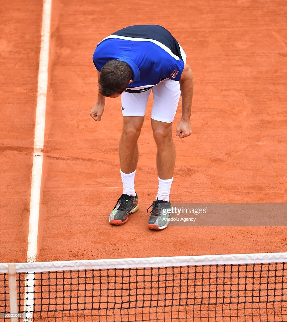 Albert Ramos-Vinolas of Spain celebrates his victory after winning the men's single fourth round match against Milos Raonic (not seen) of Canada at the French Open tennis tournament at Roland Garros Stadium in Paris, France on May 29, 2016.
