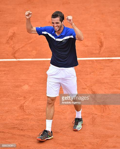 Albert RamosVinolas of Spain celebrates his victory after winning the men's single fourth round match against Milos Raonic of Canada at the French...