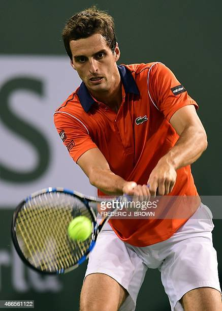 Albert RamosVinolas of Spain hits a backhand return against Novak Djokovic of Serbia during their 3rd round match at the BNP Paribas Tennis Open in...