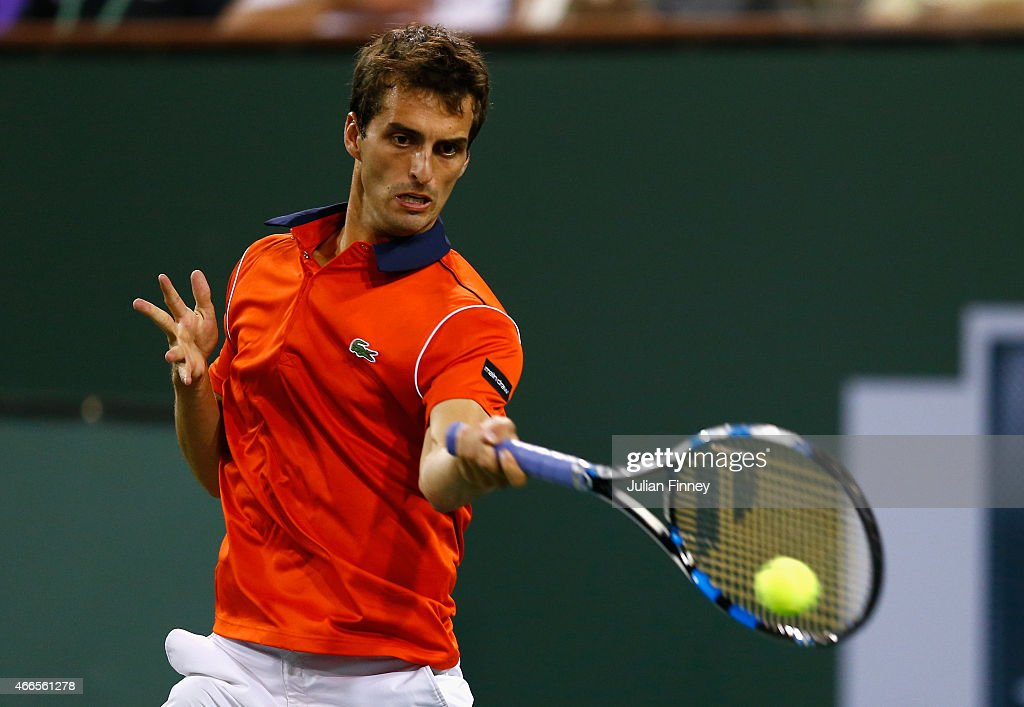 <a gi-track='captionPersonalityLinkClicked' href=/galleries/search?phrase=Albert+Ramos&family=editorial&specificpeople=6878507 ng-click='$event.stopPropagation()'>Albert Ramos</a>-Vinolas of Spain in action against Novak Djokovic of Serbiaduring day eight of the BNP Paribas Open tennis at the Indian Wells Tennis Garden on March 16, 2015 in Indian Wells, California.