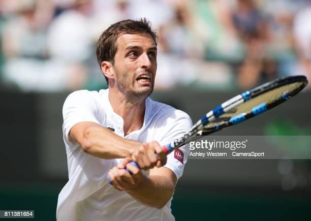 Albert RamosVinolas of Spain in action during his defeat to Milos Raonic of Canada in their Men's Singles Third Round Match at Wimbledon on July 8...