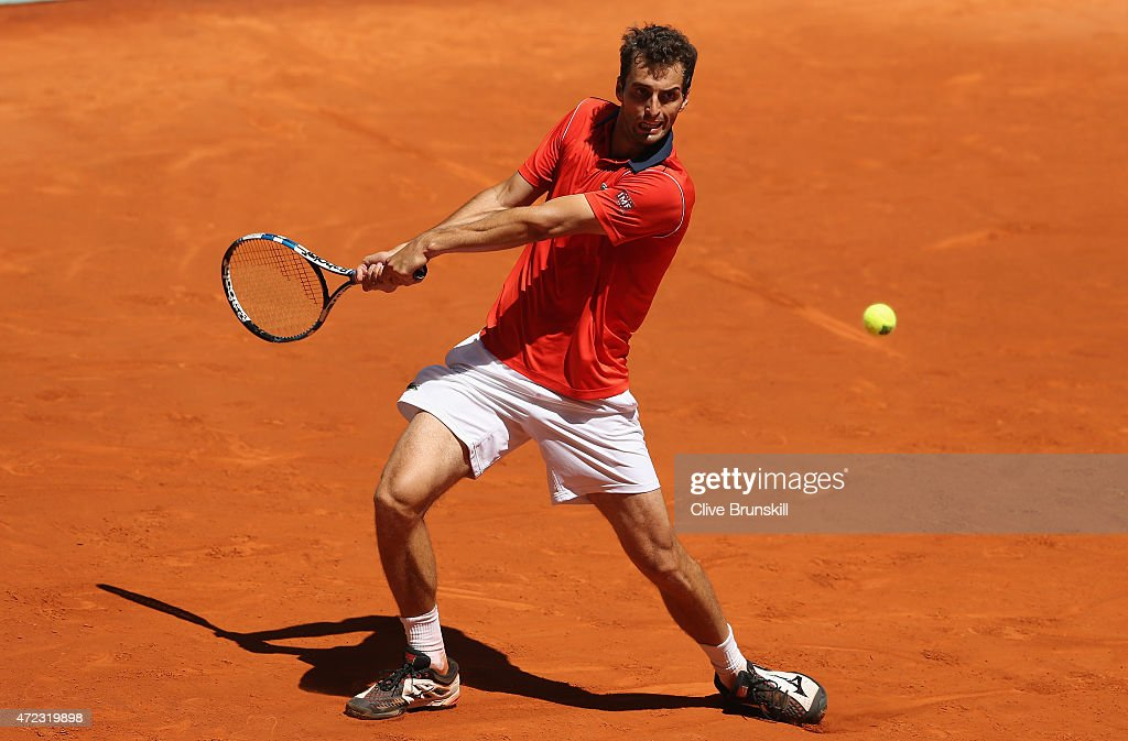 Albert Ramos-Vinolas of Spain plays a backhand against David Ferrer of Spain in their second round match during day five of the Mutua Madrid Open tennis tournament at the Caja Magica on May 6, 2015 in Madrid, Spain.
