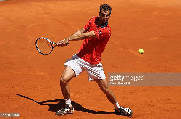 Albert RamosVinolas of Spain plays a backhand against David Ferrer of Spain in their second round match during day five of the Mutua Madrid Open...