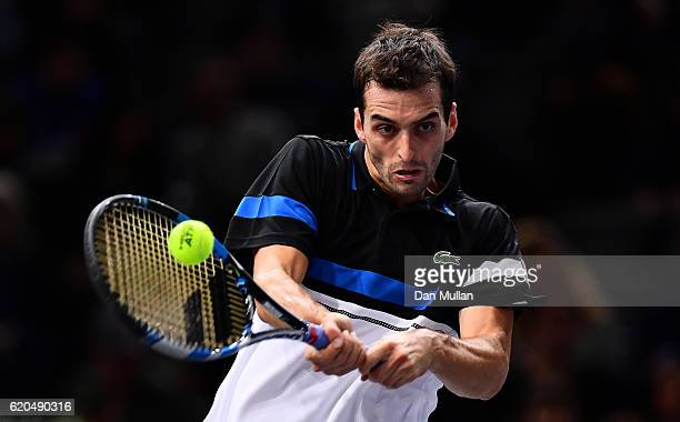 Albert RamosVinolas of Spain plays a backhand against JoWilfried Tsonga of France during the Mens Singles second round match on day three of the BNP...
