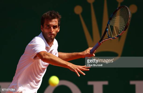 Albert RamosVinolas of Spain plays a forehand against Lucas Pouille of France in their semi final round match on day seven of the Monte Carlo Rolex...