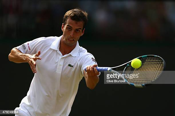 Albert RamosVinolas of Spain plays a forehand during his Gentlemens Singles Second Round match againstJoWilfried Tsonga of France during day four of...