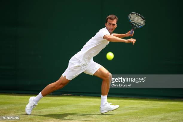Albert RamosVinolas of Spain plays a forehand during the Gentlemen's Singles first round match against Jordan Thompson of Australia on day two of the...