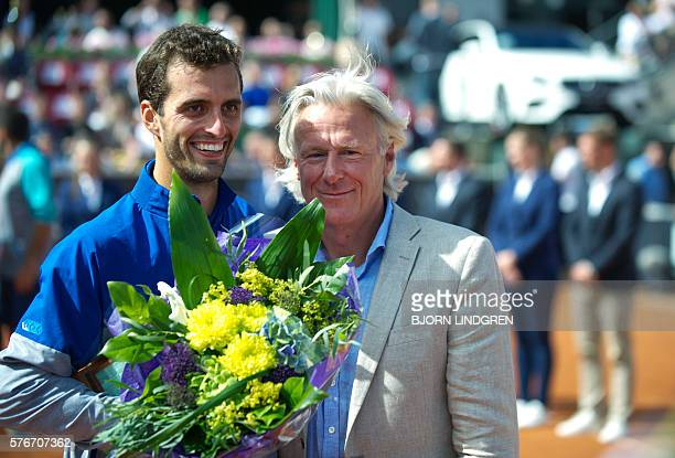 Albert RamosVinolas of Spain poses besides Bjorn Borg after winning the final tennis match against Fernando Verdasco of Spain at the Swedish Open in...