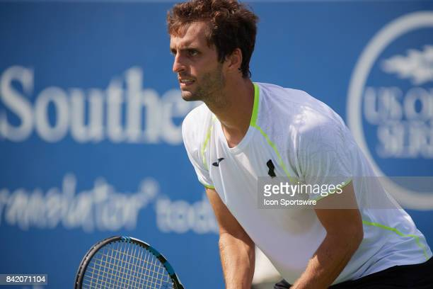 Albert RamosVinolas of Spain prepares to receive a serve during a match in the Western Southern Open at the Lindner Family Tennis Center in Mason...