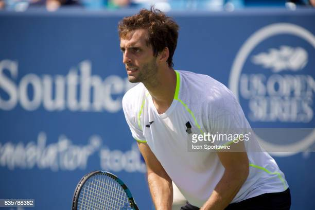Albert RamosVinolas of Spain prepares to return a serve during a match in the Western Southern Open at the Lindner Family Tennis Center in Cincinnati...