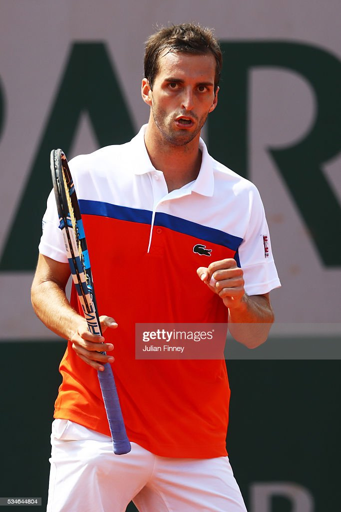 Albert Ramos-Vinolas of Spain reacts during the Men's Singles third round match against Jack Sock of the United States on day six of the 2016 French Open at Roland Garros on May 27, 2016 in Paris, France.