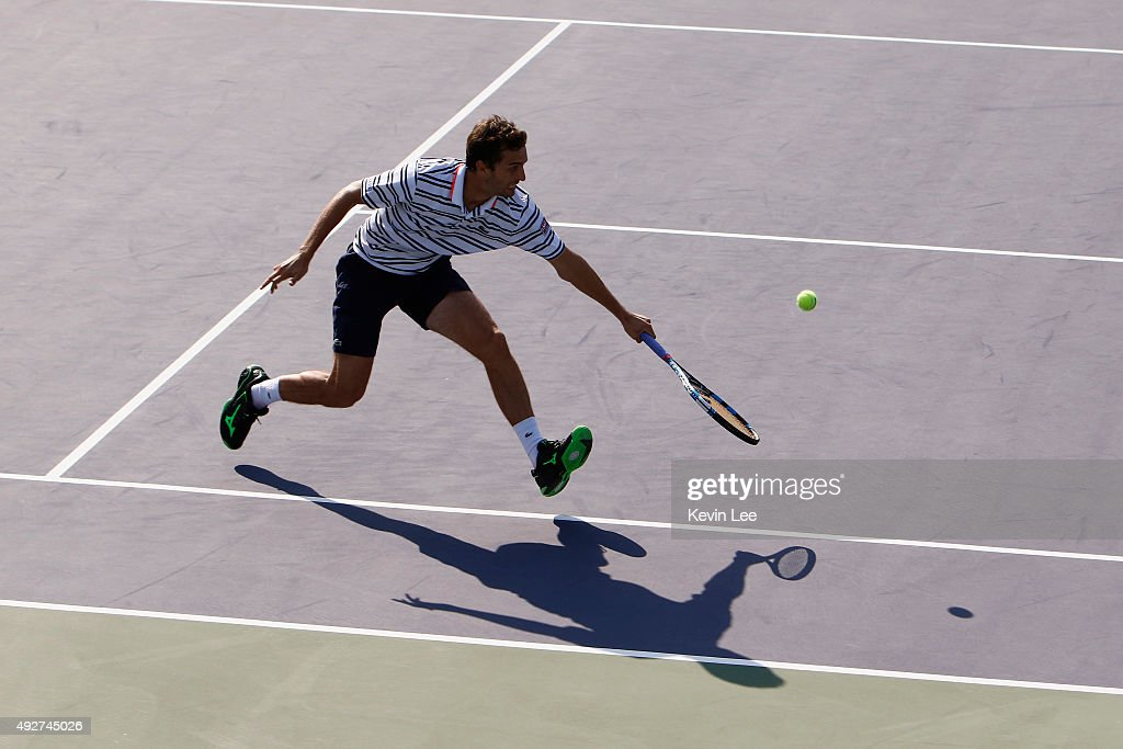 <a gi-track='captionPersonalityLinkClicked' href=/galleries/search?phrase=Albert+Ramos&family=editorial&specificpeople=6878507 ng-click='$event.stopPropagation()'>Albert Ramos</a>-Vinolas of Spain returns a shot against Jo-Wilfried Tsonga of France during their men's singles third round on day 5 of Shanghai Rolex Masters at Qi Zhong Tennis Centre on October 15, 2015 in Shanghai, China.