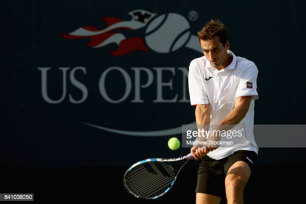 Albert RamosVinolas of Spain returns a shot against Nicolas Mahut of France during their second round Men's Singles match on Day Three of the 2017 US...