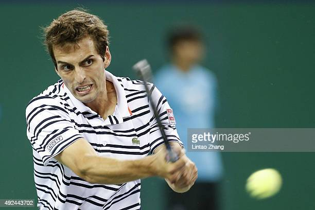 Albert RamosVinolas of Spain returns a shot against Roger Federer of Switzerland during their men's singles second round match on day 3 of Shanghai...