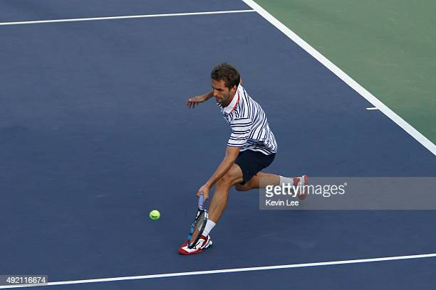 Albert RamosVinolas of Spain returns a shot to Zhizhen Zhang of China on the preview of Shanghai Rolex Mastes 2015 at Qi Zhong Tennis Centre on...