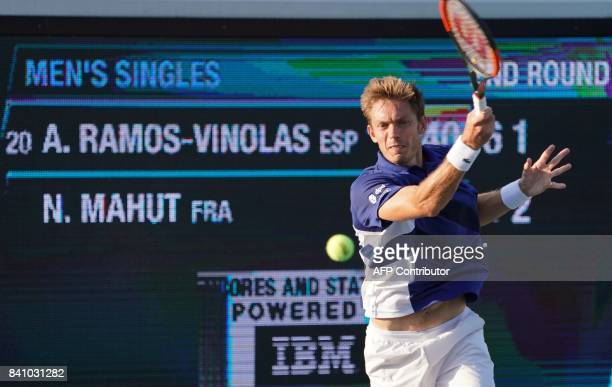 Albert RamosVinolas of Spain returns against Nicolas Mahut of France during their 2017 US Open Tennis Tournament match on August 30 2017 in New York...