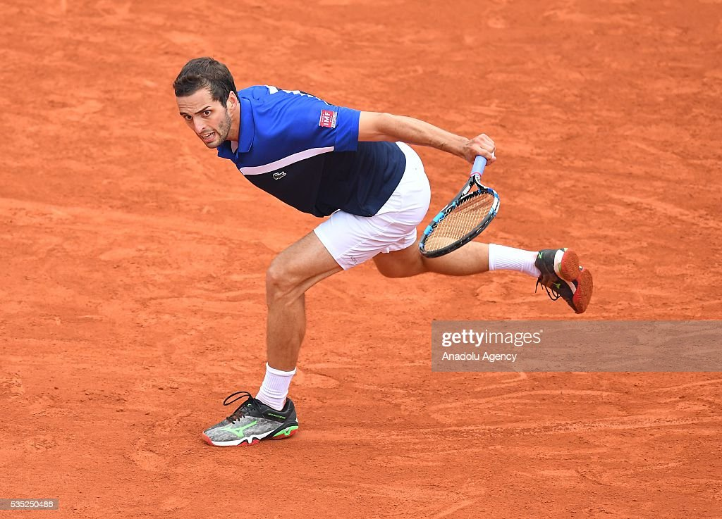 Albert Ramos-Vinolas of Spain returns to Milos Raonic (not seen) of Canada during the men's single fourth round match at the French Open tennis tournament at Roland Garros Stadium in Paris, France on May 29, 2016.