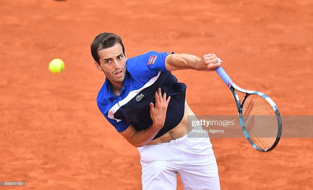 Albert Ramos-Vinolas of Spain serves to Milos Raonic (not seen) of Canada during the men's single fourth round match at the French Open tennis tournament at Roland Garros Stadium in Paris, France on May 29, 2016.