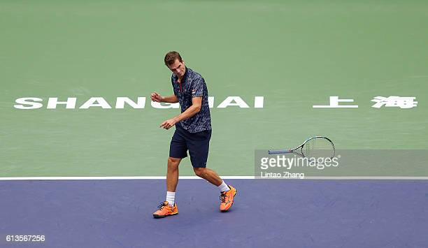 Albert RamosVinolas of Spain smashes his racquet in frustration during against Fabio Fognini of Italy in the Men's singles match on day one of...