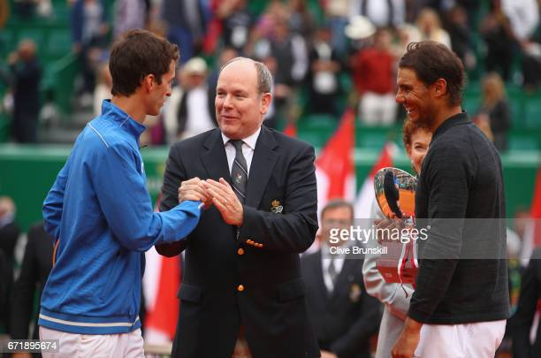 Albert RamosVinolas of Spain talks to Prince Albert ll of Monaco after his straight set defeat by Rafael Nadal of Spain in the final on day eight of...