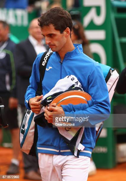 Albert RamosVinolas of Spain walks off court with his runner up trophy after his straight set defeat by Rafael Nadal of Spain in the final on day...