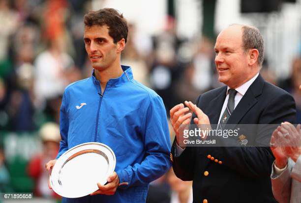 Albert RamosVinolas of Spain with Prince Albert ll of Monaco after his straight set defeat by Rafael Nadal of Spain in the final on day eight of the...