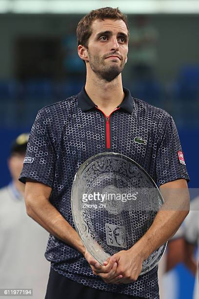 Albert RamosVinolas of Spain with the trophy after losing the singles final match against Karen Khachanov of Russia on Day 7 of 2016 ATP Chengdu Open...