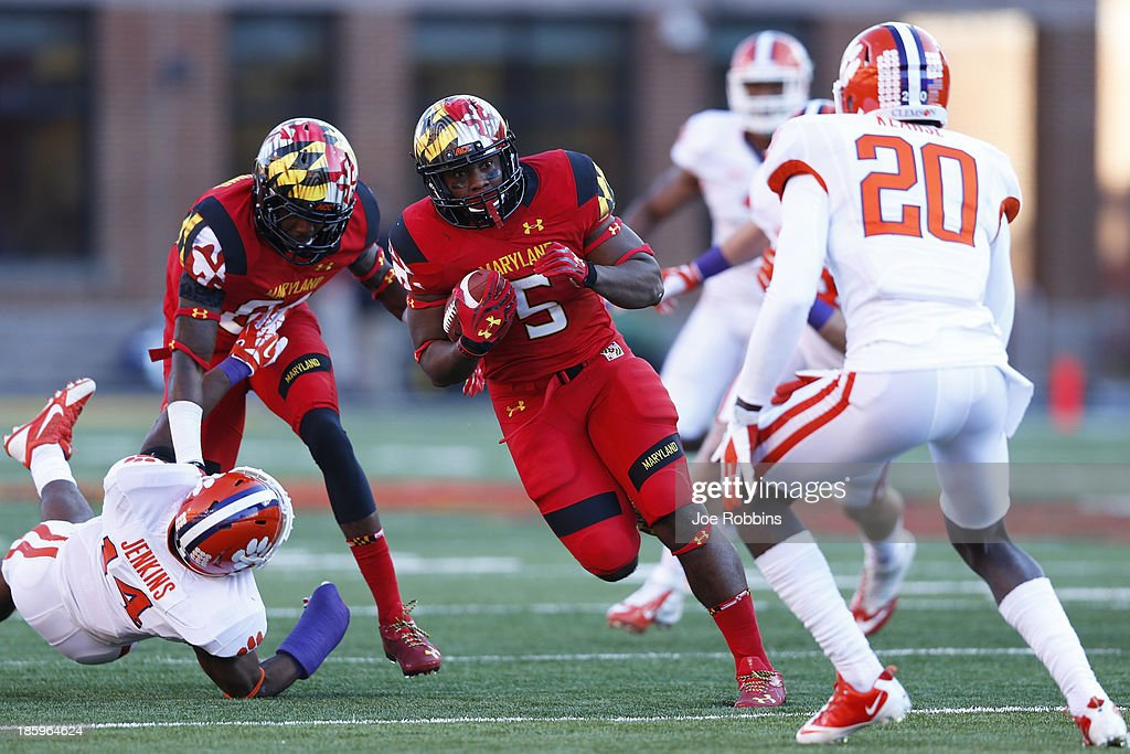 Albert Reid #5 of the Maryland Terrapins runs downfield with the ball against the Clemson Tigers during the game at Byrd Stadium on October 26, 2013 in College Park, Maryland. Clemson won 40-27.