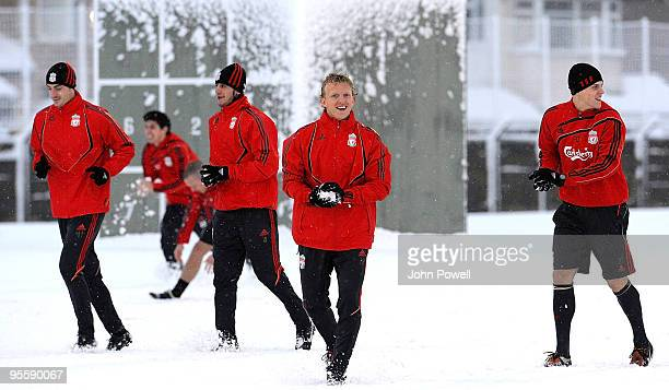 Albert Riera Alberto Aquilani Dirk Kuyt and Martin Skrtel train in the snow during a training session at Melwood Training Ground on January 5 2010 in...