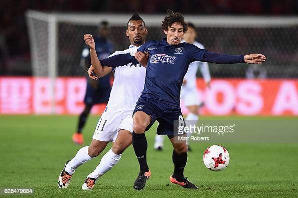 Albert Riera of Auckland City competes for the ball against Fabricio of Kashima Antlers during the FIFA Club World Cup Playoff for Quarter Final...