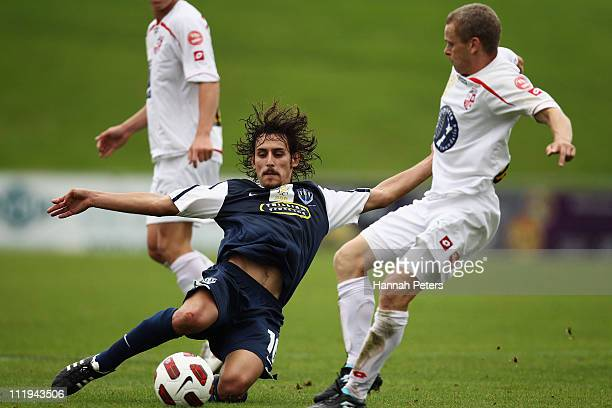 Albert Riera of Auckland kicks the ball through as Martin Bullock of Waitakere tackles during the ASB Premiership Final between Auckland City and...