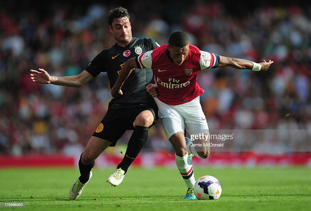 <a gi-track='captionPersonalityLinkClicked' href=/galleries/search?phrase=Albert+Riera&family=editorial&specificpeople=657194 ng-click='$event.stopPropagation()'>Albert Riera</a> of Galatasaray battles with Alex Oxlade Chamberlain of Arsenal during the Emirates Cup match between Arsenal and Galatasaray at the Emirates Stadium on August 4, 2013 in London, England.