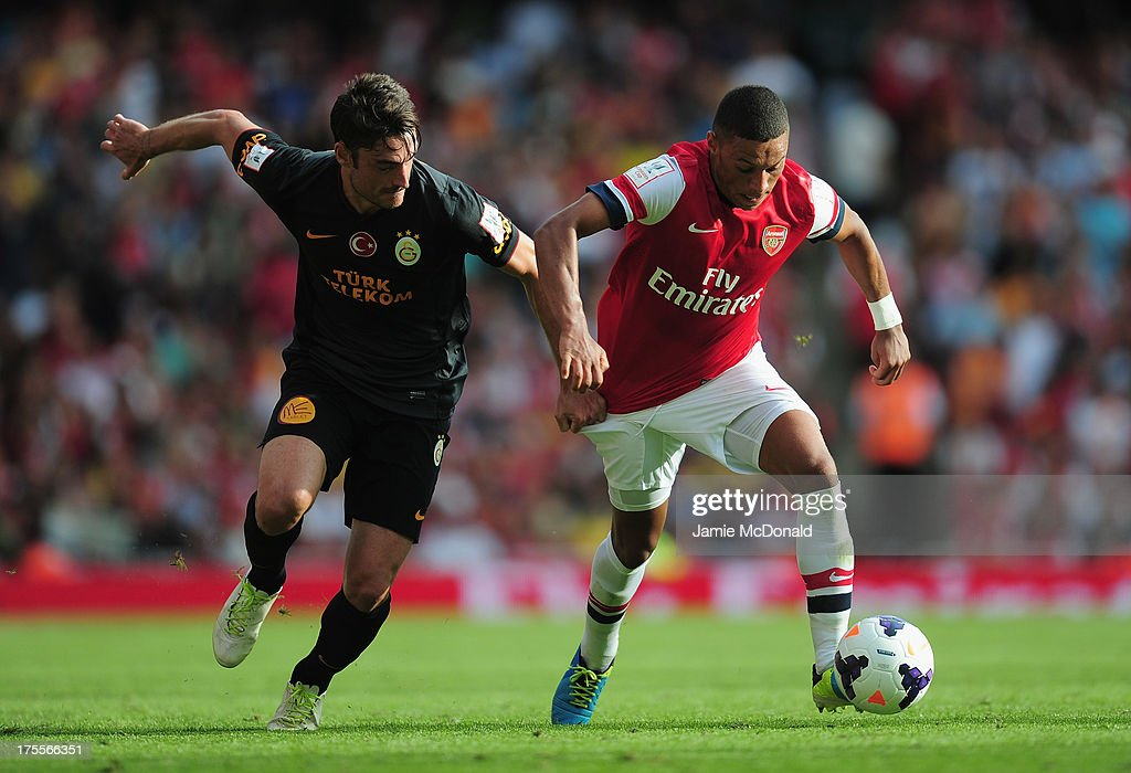 Albert Riera of Galatasaray battles with Alex Oxlade Chamberlain of Arsenal during the Emirates Cup match between Arsenal and Galatasaray at the Emirates Stadium on August 4, 2013 in London, England.