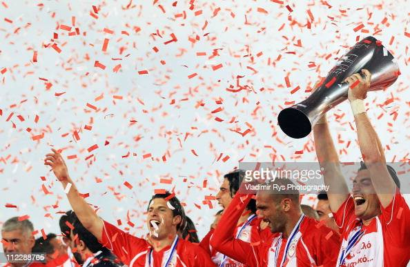 Albert Riera of Olympiacos races the winner's trophy after finishing first with Olympiacos in the regular season and claiming it's historicaly 38th...