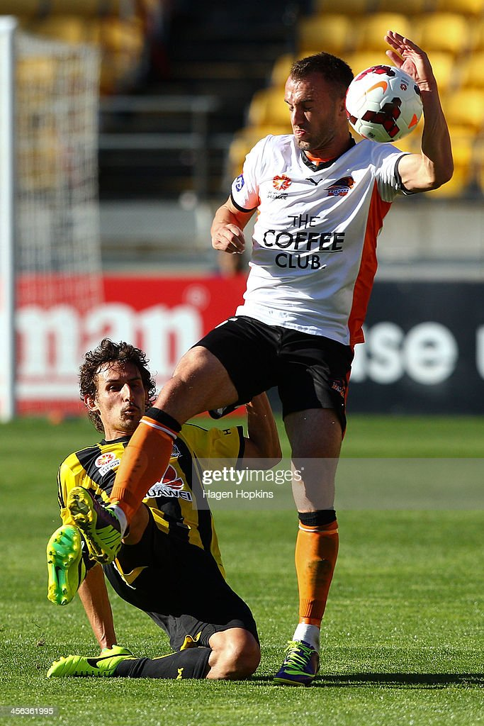 Albert Riera of the Phoenix and Ivan Franjic of the Roar compete for the ball during the round 10 A-League match between the Wellington Phoenix and Brisbane Roar at Westpac Stadium on December 14, 2013 in Wellington, New Zealand.
