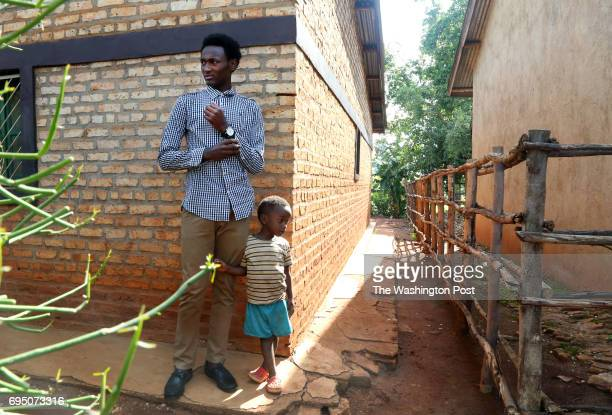 Albert right who declined to use his last name because of the stigma surrounding his situation shucks corn with his mother Agnes center and his...