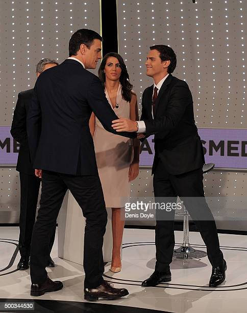 Albert Rivera of Ciudadanos political party shakes hands with Pedro Sanchez leader of the PSOE socialist party before their television debate with...