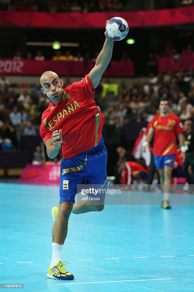 <a gi-track='captionPersonalityLinkClicked' href=/galleries/search?phrase=Albert+Rocas&family=editorial&specificpeople=855149 ng-click='$event.stopPropagation()'>Albert Rocas</a> Comas of Spain shoots at goal during the Men's Handball preliminaries group B match between Spain and Serbia on Day 2 of the London 2012 Olympic Games at the Copper Box on July 29, 2012 in London, England.